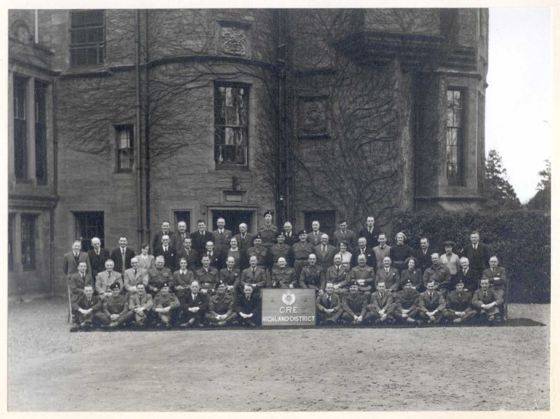 Group photograph of Highland District Company of Royal Engineers staff, taken outside Balhousie Castle. Undated, but ~1950s, when the Castle served as the Headquarters for CRE Highland District.