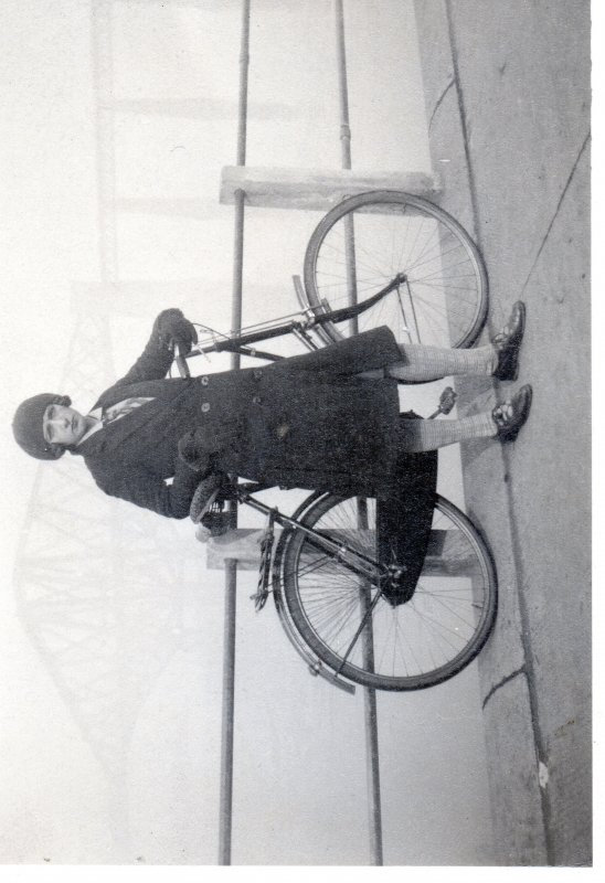 1930s woman and bicycle before Forth Bridge