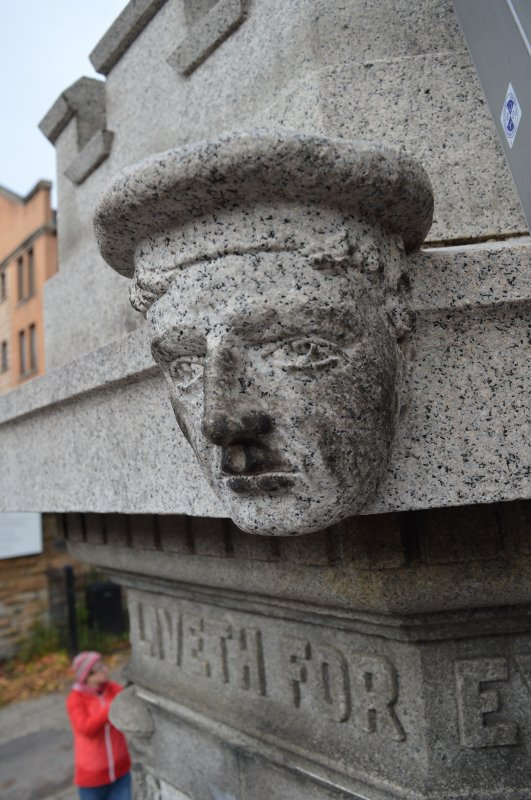 This is one of four heads, two soldiers and two sailors, on the Govan War Memorial. This head of a sailor is at the south-east corner of the monument.