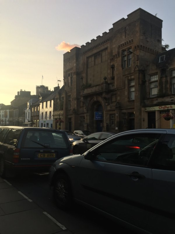 Image of the Victoria Hall in the evening from the pavement of Linlithgow High Street