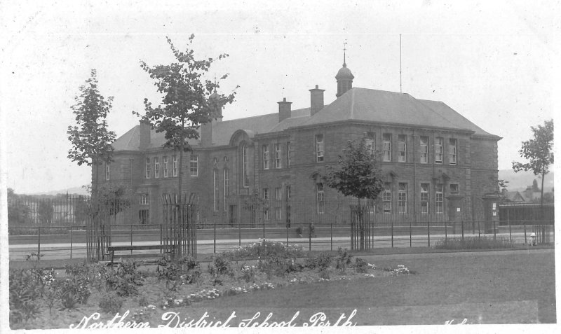 "View from west (Dunkeld Road). Postcard (publisher/photographer unknown) sent to Arbroath with message ""This is a view of the school we are billeted in, it is a nice place."" Year of posting illegible; the stamp is a George V 1/2d green (in use January 1912-June 1918). It was apparently sent by a soldier during World War I, most likely in the early years when accommodation for troops had to be found in any convenient buildings. The photo was probably taken soon after the school opened in 1908."