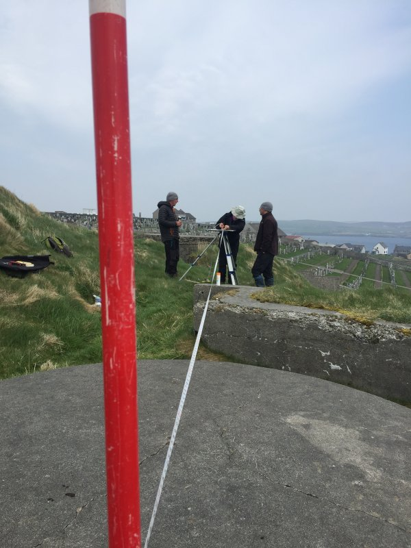 Scotland's Urban Past training volunteer from Shetland Archaeology on how to plane table survey. Lerwick defences.