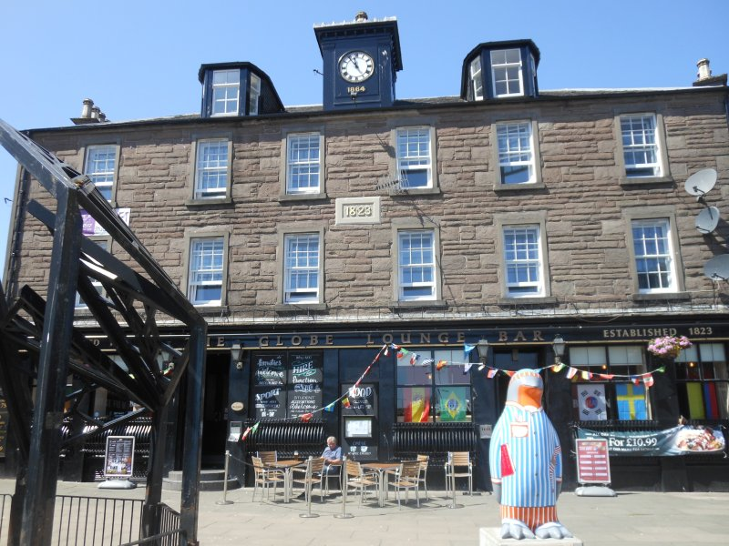 Globe Bar from July 2018 with Maggie's Penguin Parade statue displayed at its frontage