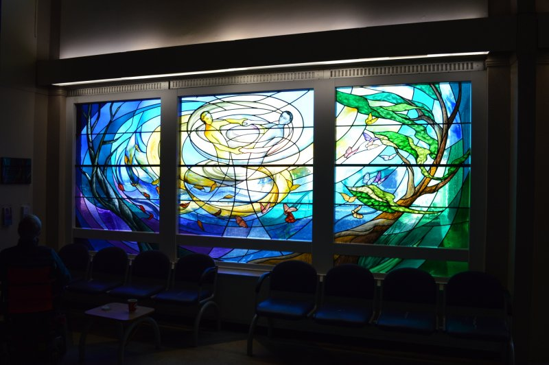 Stained glass by Liz Rowley commemorating organ donors, added to the main waiting area at Ninewells Hospital in 2013. Photographed July 2018.