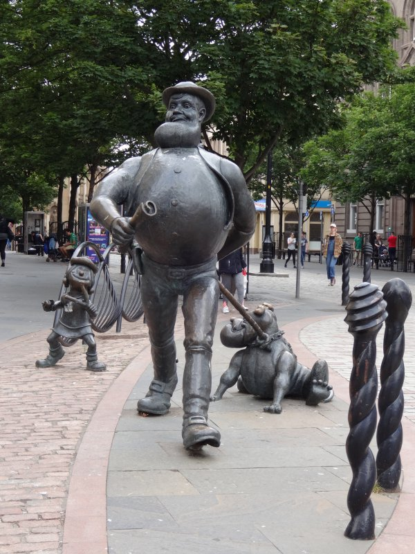 This is a side on view of Desperate Dan and Dawg along with Minnie the Minx