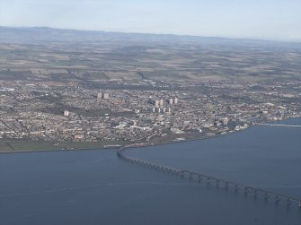 General oblique aerial view looking across the Firth of Tay, the road and rail bridges towards the city of Dundee, taken from the SSW.