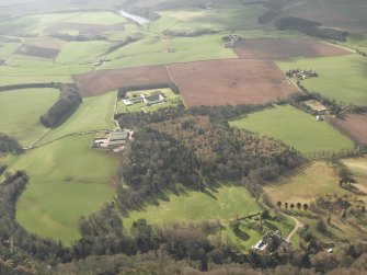 General oblique aerial view of the abbey, country house and towerhouse, taken from the NE.