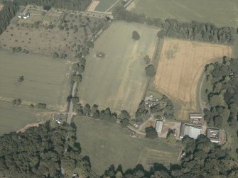 General oblique aerial view of the country house and the farmsteading, taken from the W.