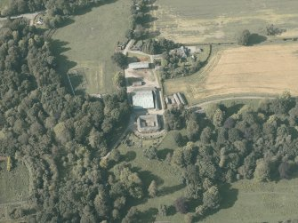Oblique aerial view centred on the farmsteading, taken from the S.