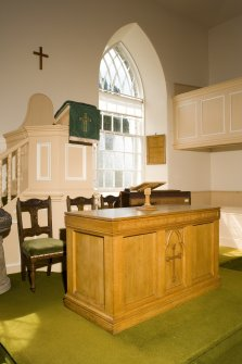 Interior. View of communion table and pulpit