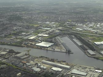 General oblique aerial view looking over the docks, taken from the NNE.