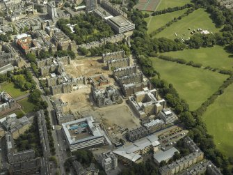 Oblique aerial view of the hospital during redevelopment with the dental institute adjacent, taken from the WNW.