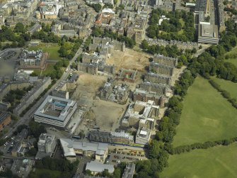 Aerial view of the old Edinburgh Royal Infirmary site during redevelopment with the dental institute adjacent, taken from the WSW.