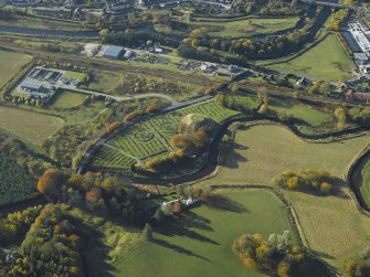 General oblique aerial view centred on the remains of the motte and bailey castle and the cemetery, taken from the NE.