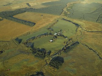 Oblique aerial view centred on the farmhouse and remains of the rig, taken from the SSE.