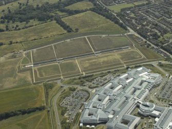 General oblique aerial view centred on the biomedical research park with the hospital adjacent, taken from the NW.