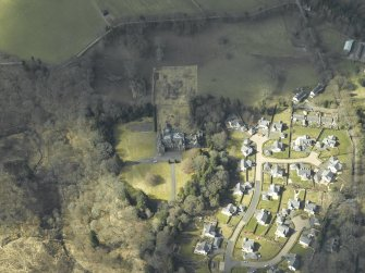 Oblique aerial view centred on the country house and housing estate, taken from the E.