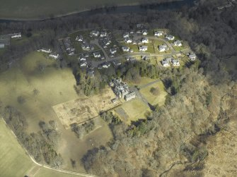 Oblique aerial view centred on the country house and housing estate, taken from the SW.