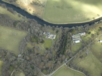 Oblique aerial view centred on the country house with the farmsteading, farmhouse and lodge adjacent, taken from the SW.