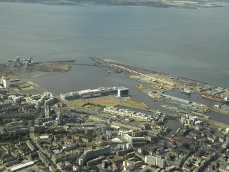 General oblique aerial view centred on the offices, road bridges, swing bridge, harbours, shopping centre, cinema, restaurants, visitor centre, dock and shed, taken from the SW.