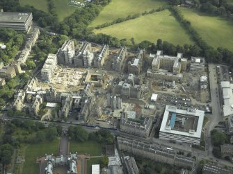 Oblique aerial view centred on the redevelopment of the hospital for housing, taken from the NNW.