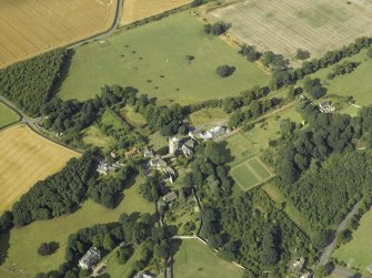 General oblique aerial view centred on the abbey, church, manse, burial-ground, school and country house, taken from the SW.