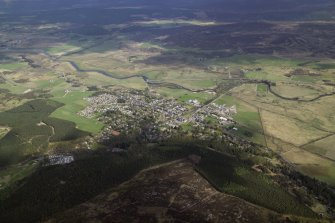 General oblique aerial view looking over Kingussie with the remains of the barracks adjacent, taken from the NW.