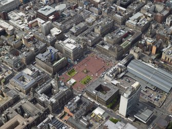 Oblique aerial view centred on the city chambers and square with the station adjacent, taken from the NE.