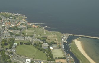 General oblique aerial view of the town centred on the remains of the cathedral and the harbour with the remains of the castle adjacent, taken from the S.