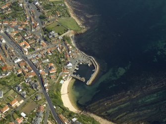 General oblique aerial view of the town centred on the harbour, taken from the WSW.