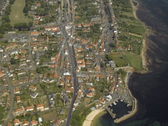 General oblique aerial view of the town with the harbour in the foreground, taken from the SW.