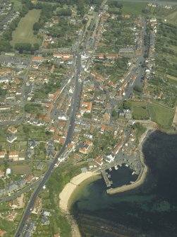 General oblique aerial view of the town centred on the harbour, taken from the SSW.