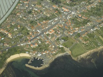 General oblique aerial view of the town centred on the harbour, taken from the SSE.