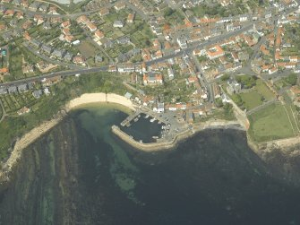 General oblique aerial view of the town centred on the harbour, taken from the SE.