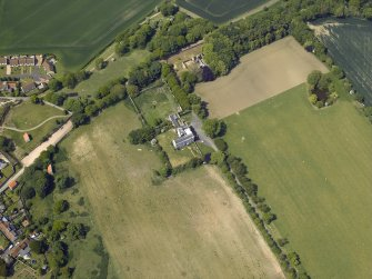 Oblique aerial view centred on the country house, garden and stables with the dovecots adjacent, taken from the ESE.