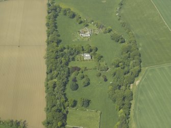 Oblique aerial view centred on the country house and stables, taken from the SE.