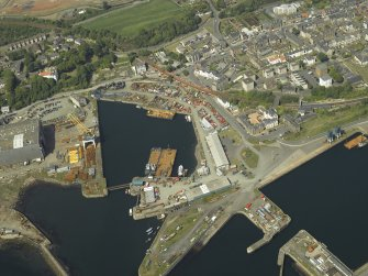 Oblique aerial view of the harbour centred on the dock and engine house, taken from the S.