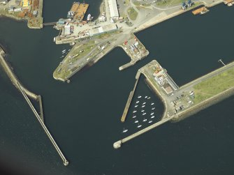 Oblique aerial view of the harbour centred on the outer harbour and breakwaters, taken from the S.