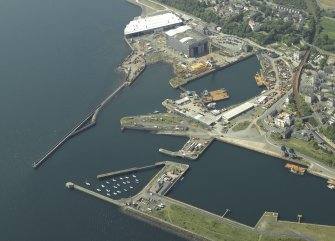 Oblique aerial view centred on the harbour, taken from the ESE.