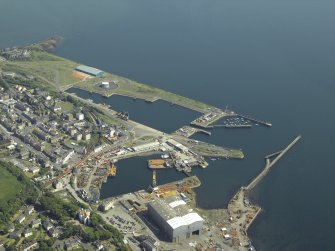 General oblique aerial view centred on the harbour, taken from the WNW.