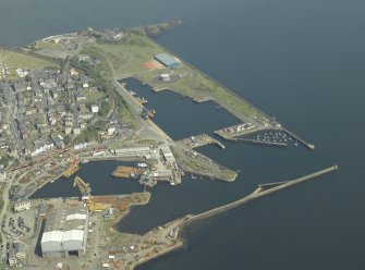 General oblique aerial view centred on the harbour, taken from the WSW.