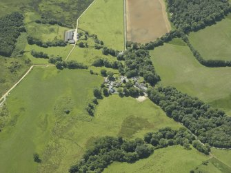 General oblique aerial view centred on the village, taken from the NE.