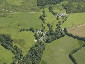 General oblique aerial view centred on the village, taken from the NW.