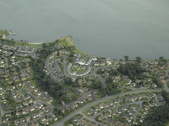 General oblique aerial view of the town centred on the house, taken from the NW.