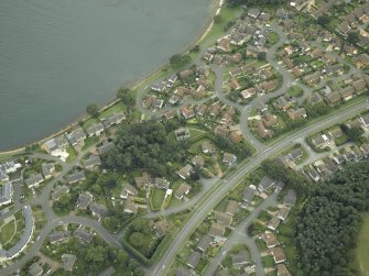 Oblique aerial view of the town centred on the remains of the chapel, taken from the N.