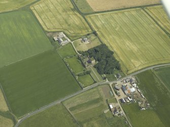 Oblique aerial view centred on the remains of the castle and tower-house, taken from the WNW.