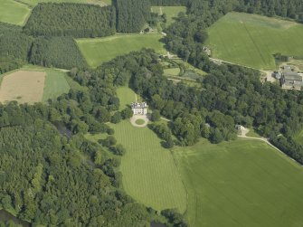 Oblique aerial view centred on the castle, tower-house and walled garden, taken from the WNW.
