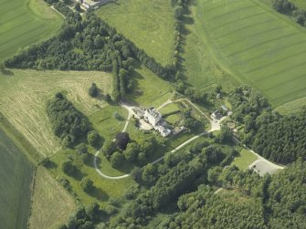 Oblique aerial view centred on the country house, dovecot, and remains of the chapel, taken from the SE.