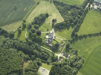 Oblique aerial view centred on the country house, dovecot, and remains of the chapel, taken from the NE.