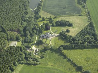 Oblique aerial view centred on the country house, dovecot, and remains of the chapel, taken from the N.